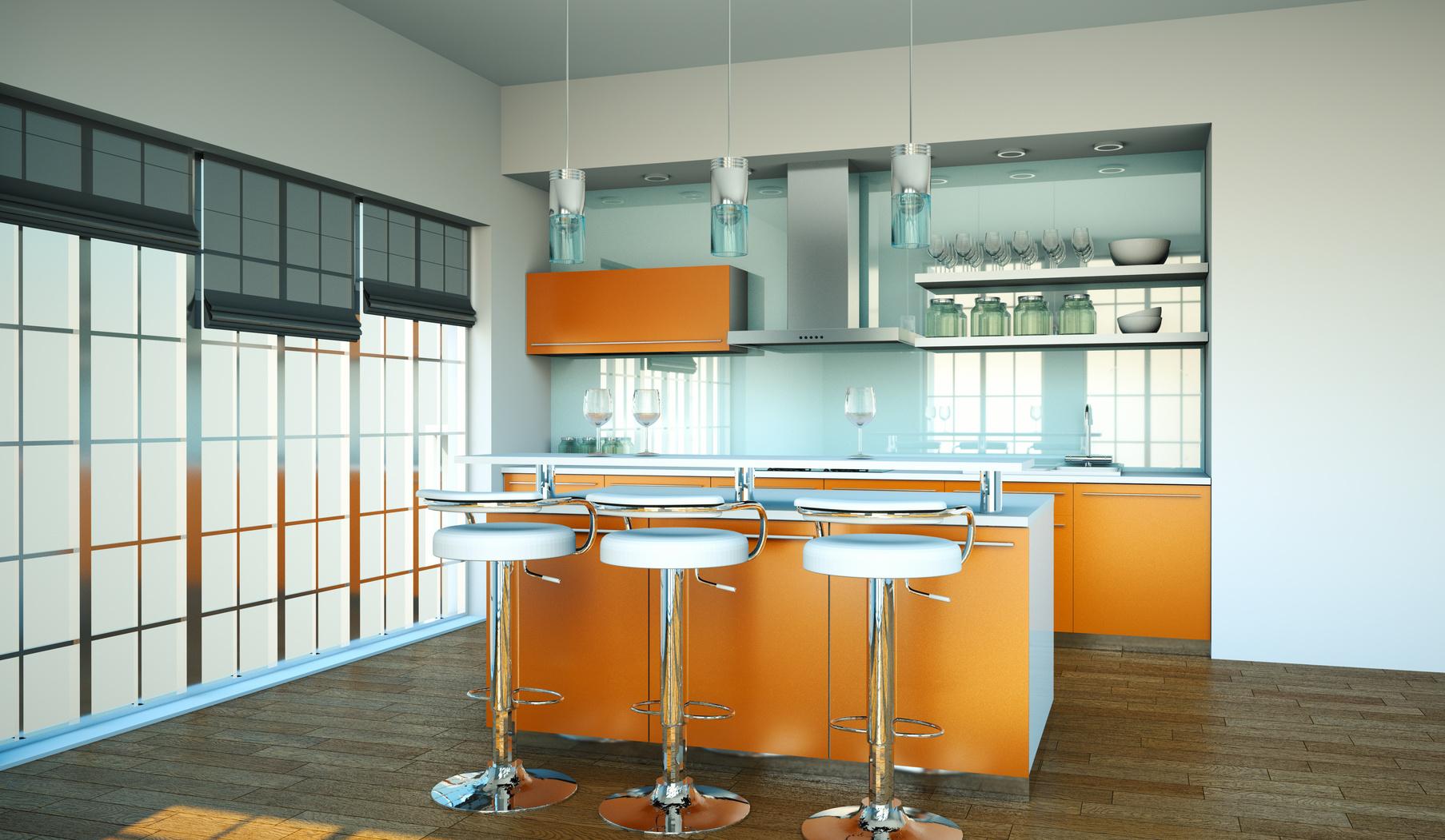 Moderní kuchyňský kout v oranžové barvě s ostrůvkem.