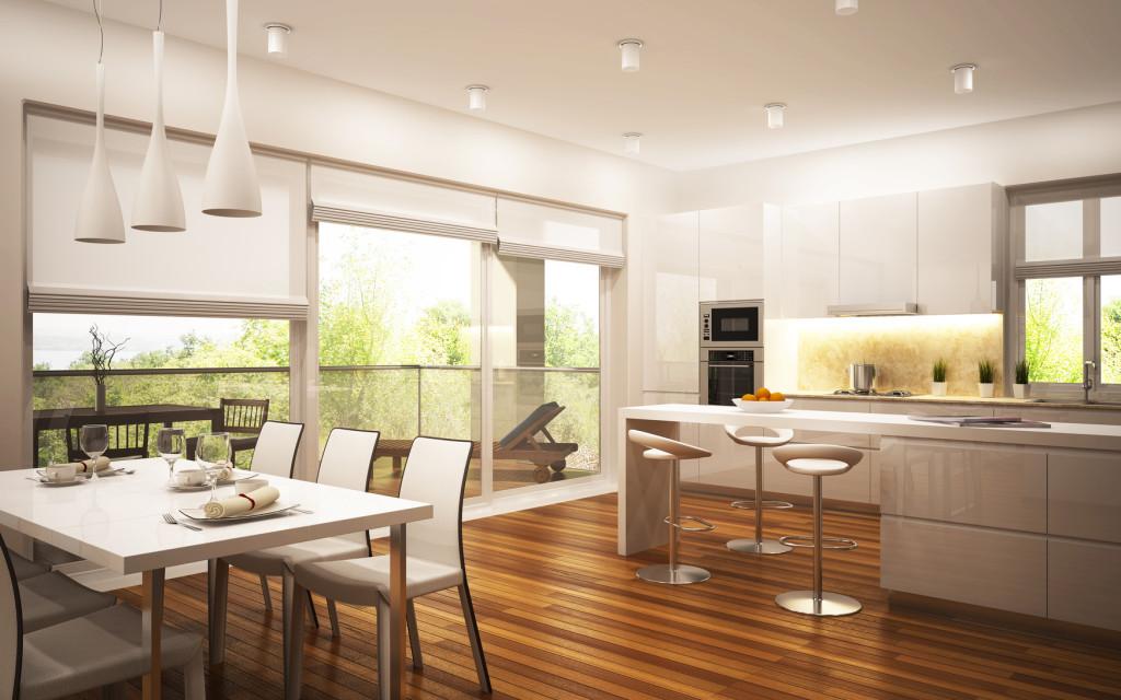 Světlá prostorná kuchyně v moderním stylu.